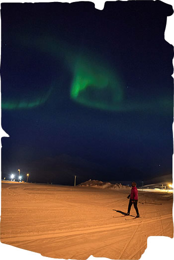 Cross-country skiing under the Northern Lights
